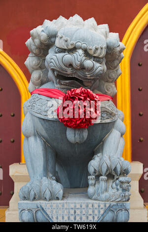 Stone statue of lion in Huaning Temple, Yining (Ghulja), Xinjiang Province, China - Stock Image