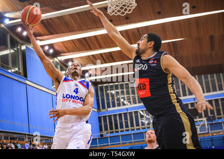 London, UK, 20th April 2019. Royals' AJ Roberts (4) tries to push the ball to the basket, with Kieron Achara (20) blocking for Rocks. Tensions run high in the London City Royals v Glasgow Rocks BBL Championship game at Crystal Palace Sports Centre. Home team LCR win the tight game 78-70. Credit: Imageplotter/Alamy Live News - Stock Image