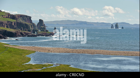 Sea cliffs and sea stacks 'The Drongs' of the Eshaness coastline, seen from Braewick, Shetland mainland. - Stock Image