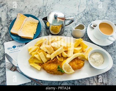 Over 65's Special Fish & Chips a small Cod with white bread and butter cup of tea and tartare sauce at Seaview Restaurant Saltburn Yorkshire England - Stock Image