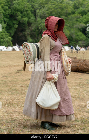 Duncan Mills, CA - July 14, 2018: Lady dressed in costume at a civil war re-enactement. The Civil War Days is one of the largest reenactment events on - Stock Image