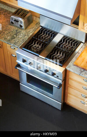Gas range and oven in kitchen - Stock Image