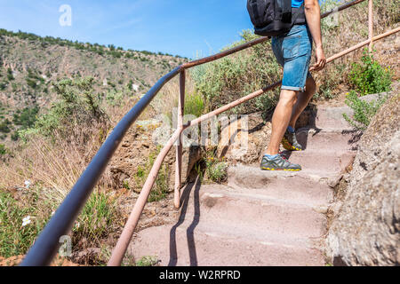 Los Alamos park with man walking up steps of Main Loop trail path in Bandelier National Monument in New Mexico - Stock Image