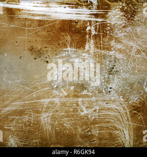 Brown grunge textured background with scratches and grain - Stock Image