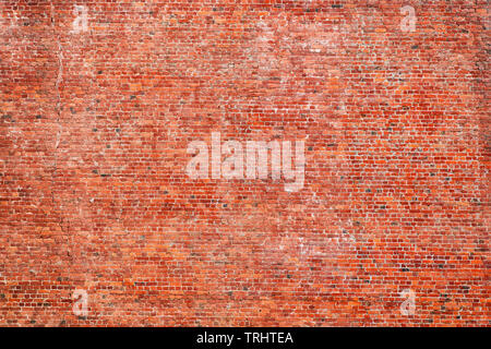 Large red rough brick wall. Texture and background - Stock Image