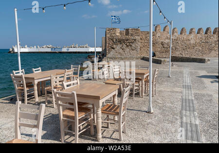 Ierapetra, Crete, Greece. June 2019. Empty chairs and tables on the quayside of this southern Crete resort. - Stock Image