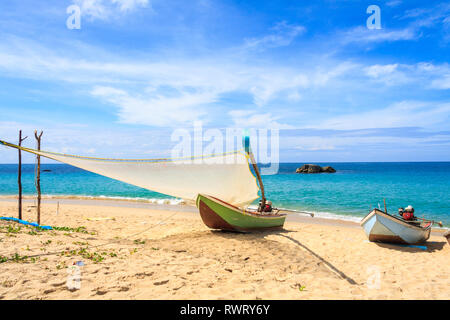 Fishing boat with sail on Natai beach, Phang Nga , Thailand - Stock Image