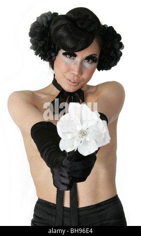 Portrait of a Burlesque Performer Offering a White Flower - Stock Image