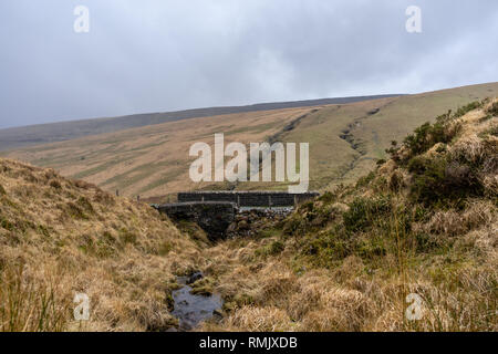 Small cobbled stone bridge within the Brecon Beacons National Park lanscape, South Wales, UK - Stock Image