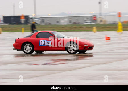 A 1994 Red Mazda RX-7 in an autocross race at a regional Sports Car Club of America (SCCA) event - Stock Image