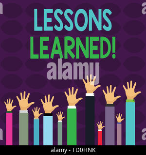 Handwriting text writing Lessons Learned. Conceptual photo experiences distilled project that should actively taken Hands of Several Businessmen Raisi - Stock Image