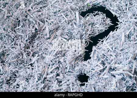 Heap of shredded paper with a symbol of question mark. concept of Questions and secret - Stock Image