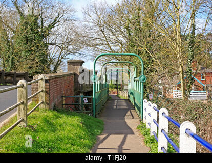 A pedestrian footbridge by the side of the B1150 road crossing the River Bure at Coltishall, Norfolk, England, United Kingdom, Europe. - Stock Image