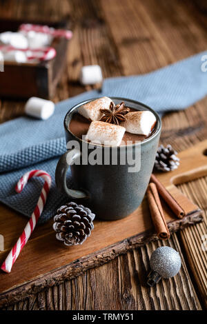 Delicious hot chocolate with marshmallows, sprinkled with cinnamon - Stock Image