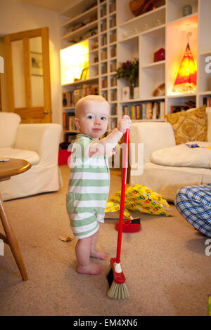 Baby boy with a brush - Stock Image