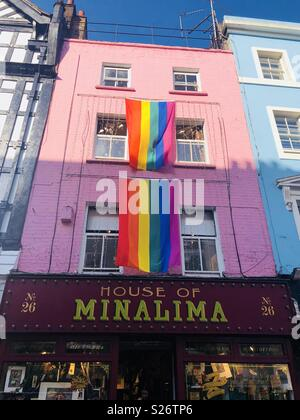 Pride rainbow flags hanging on Greek street, soho, London above house of minalima - Stock Image