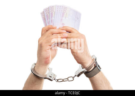 Closeup of handcuffed man presenting cash money as corruption concept isolated on white studio background - Stock Image