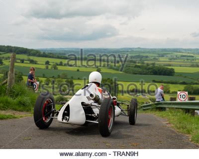 Harewood Hillclimb, Harewood, Yorkshire, UK. 1st June 2019. The annual Classic and Vintage hill climb competition for classic and vintage cars at this well known venue in the Yorkshire countryside. Competitors making their way down to the start line for their timed runs up the hill in an effort to achieve the fastest time for their class of car. Credit: Gary Clarke/Alamy Live News - Stock Image