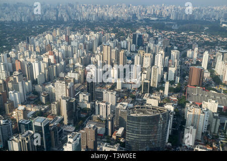 Aerial view of the city of Sao Paulo, Brazil - dense populated neighborhood - Itaim Bibi district, Credit Suisse building in foreground -  mixed with green upper-class area in background (Jardins district ) and Ibirapuera Park at right. - Stock Image