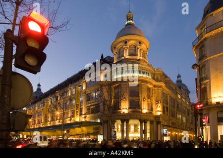 Paris France Printemps department store left bd Hausmann at dusk Galerie Lafayette right - Stock Image