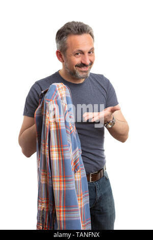 Friendly man presenting orange and blue plaid shirt in hand as casual male fashion concept isolated on white background - Stock Image