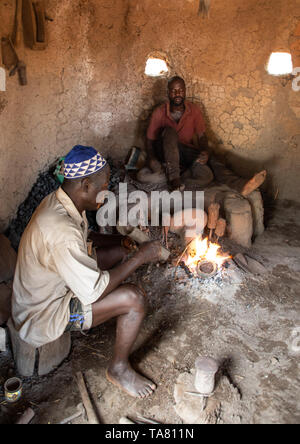 Senufo blacksmith working in his workshop, Poro region, Koni, Ivory Coast - Stock Image
