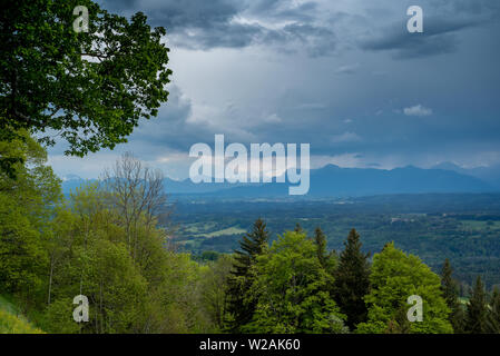 View of the Alps in the background in the spring during the day, from Hoher Peissenberg - Stock Image