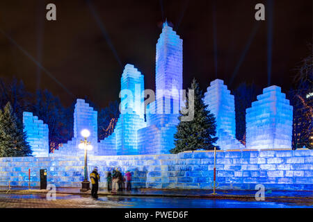 2018 Saint Paul Winter Carnival Ice Palace with blue lighting. The ice palace was built in Rice Park downtown St. Paul, Minnesota. - Stock Image