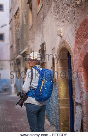 Young female tourist explores Essaouira, Morocco. - Stock Image