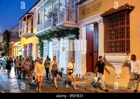 Cartagena Colombia Old Walled City Center centre Getsemani night nightlife colonial houses man woman walking strolling pedestrians - Stock Image