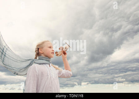 Traveling and freedom concept. Girl in White shirt and airplane - Stock Image