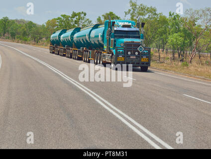 Road Train  travelling at speed through Litchfield Park region in the Northern Territory of Australia - Stock Image