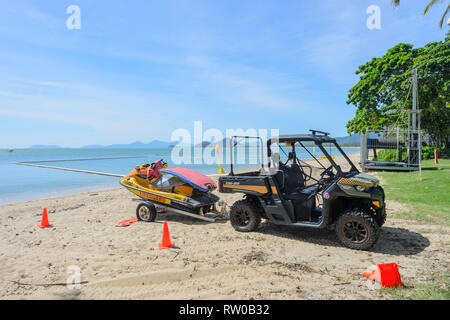 Lifeguard equipment, jetski, buggy and surfboard, Palm Cove, Cairns Northern Beaches, Far North Queensland, QLD, FNQ, Australia - Stock Image