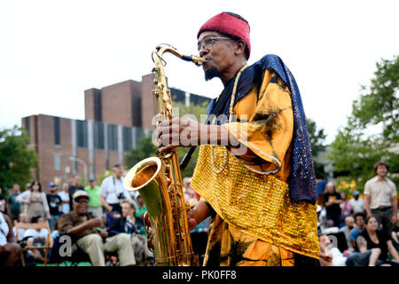 Traditionally each concert of the Sun Ra Arkestra band members leave the stage and march through the crowd while playing their hit song: Space is the  - Stock Image