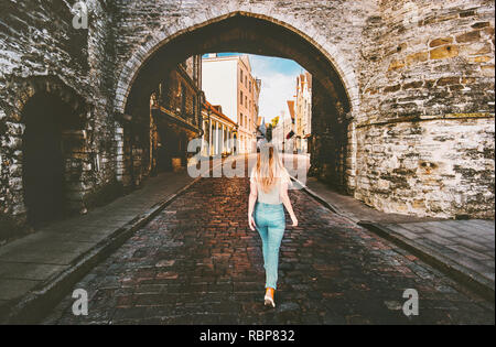 Woman tourist walking in Tallinn Old Town  solo traveling vacations in Estonia medieval cobblestone street - Stock Image