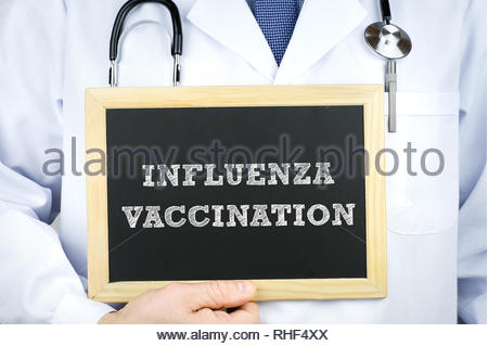 Influenza vaccination - chalkboard message - Stock Image