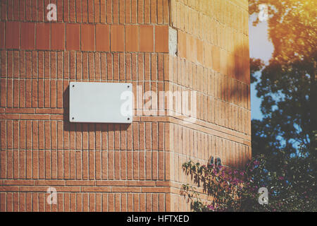 White marble classic blank house nameplate empty white space for number and text with street name on the brick wall - Stock Image