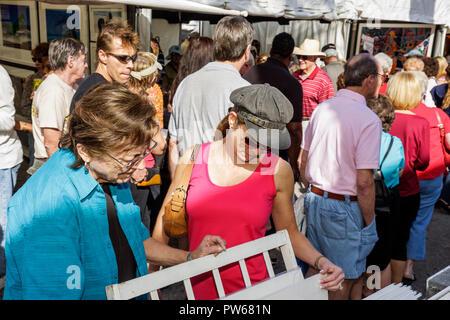 Fort Lauderdale Ft. Florida Las Olas Boulevard Las Olas Art Fair festival street fair community event art woman women crowd grou - Stock Image