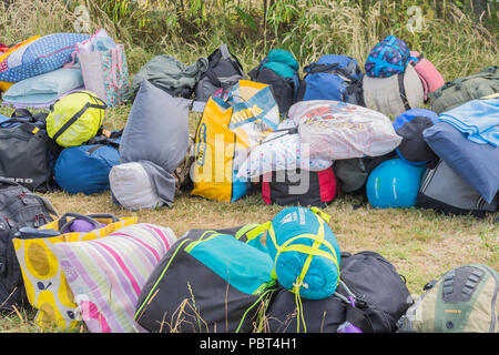 Sleeping bags, bags and paraphernalia of a school outing to a campsite. - Stock Image