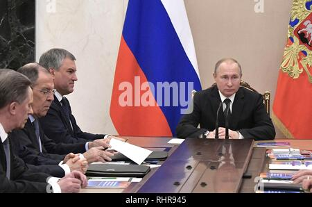 Russian President Vladimir Putin, right, holds a meeting with the permanent members of the Security Council at the Kremlin February 1, 2019 in Moscow, Russia. The meeting discussed the United States plan to withdraw from the INF disarmament agreement and the crisis in Venezuela. - Stock Image