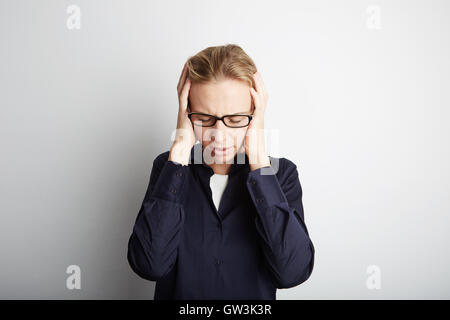 Portrait Handsome Pretty Young Woman Who Grabs Her Head Hands Headache.Empty White Background.Beauty,Grooming,Fashion - Stock Image