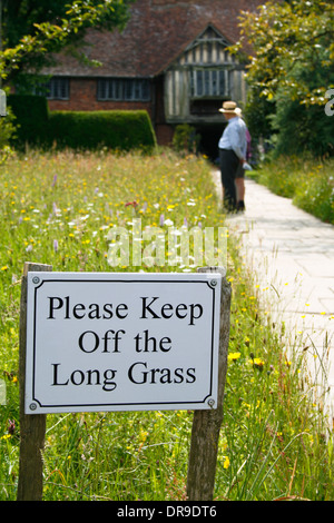 Sign: Please Keep Off the Long Grass - entrance path to Great Dixter Garden, Kent, UK. - Stock Image