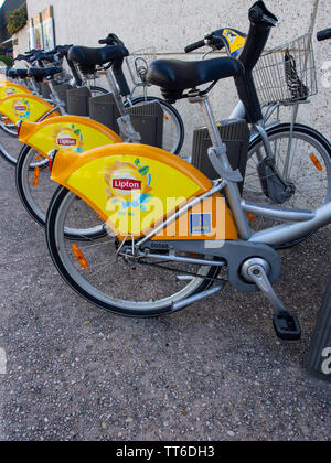 Bicycles Parked In A Bike Stand - Stock Image