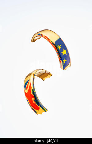 Broken Wedding Ring with Flags Symbolise Brexit - Stock Image