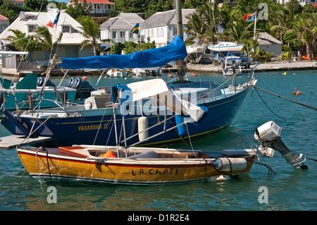 Closeup small sailboat and outboard motor boat Gustavia Harbor, Saint Barthelemy - Stock Image