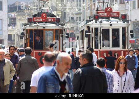 Tram on a crowded Istiklal Caddesi Street, Istanbul, Republic of Turkey - Stock Image