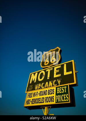 Route 66 motel sign on blue sky - Stock Image