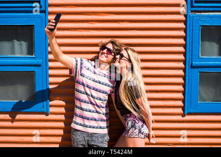 Young beautiful millennial caucasian couple of people man and woman taking selfie picture together in relationship for summer holiday - happiness and  - Stock Image