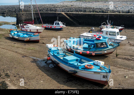 Boats at anchor at low tide in Lynmouth habour North Devon UK - Stock Image