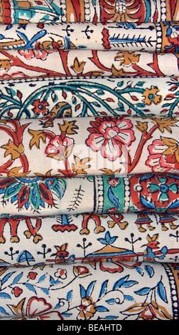 Stack of Indian printed fabric from Bagru, near Jaipur, Rajasthan, India - Stock Image